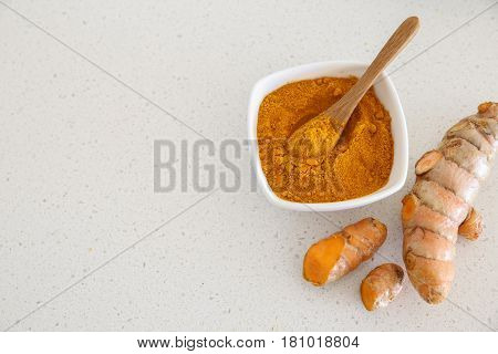 fresh turmeric root and turmeric powder copy space