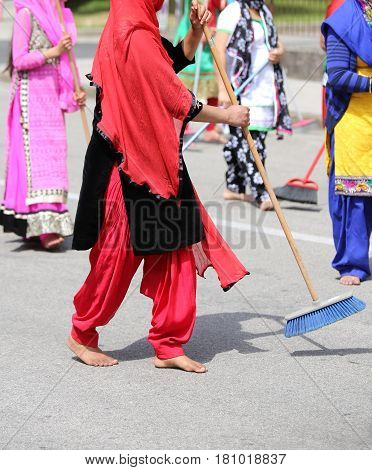 Many Sikhs  Women Barefoot While Scavenging The Road During A Si