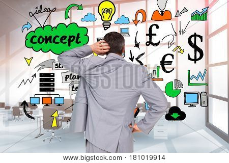 Digital composite of Rear view of confused businessman looking at doodle graphics on wall