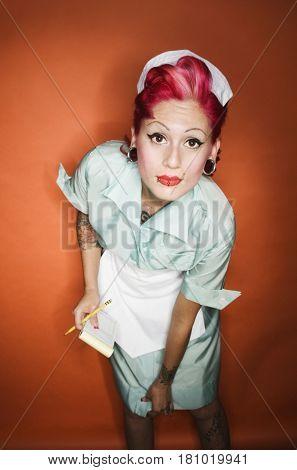 Hispanic waitress with pink hair