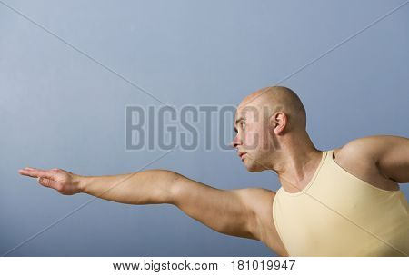 Hispanic man practicing yoga