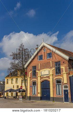 GRONINGEN, NETHERLANDS - APRIL 02, 2017: Old building and restaurant at the east harbor of Groningen, Netherlands