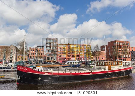 GRONINGEN, NETHERLANDS - APRIL 02, 2017: Traditional ship in the colorful east harbor of Groningen, Holland