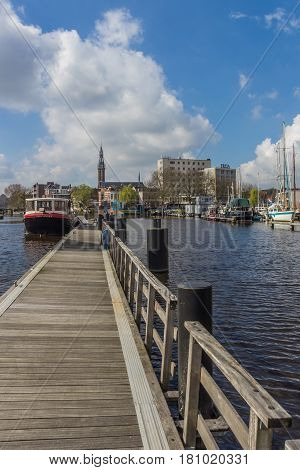 GRONINGEN, NETHERLANDS - APRIL 02, 2017: Wooden jetty in the east harbor of Groningen, Netherlands