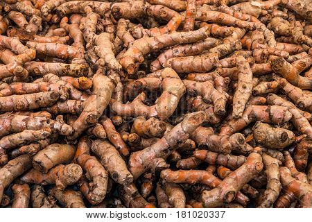 Full basket of turmeric is on display for sale in the fresh vegetable market