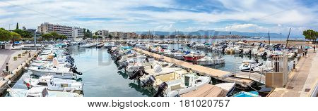 Antibes, France - June 29, 2016: day view of boats in Port de la Salis Marina in Antibes France. Antibes is a popular seaside town in the heart of the Cote d'Azur.