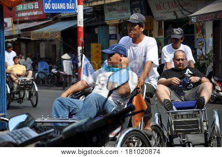 Tourist Taking A Tour With A Classic Vietnamese Rickshaw, Tuk Tuk