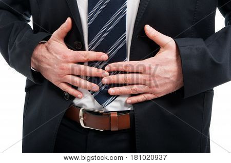 Close-up Of Elegant Man Holding His Stomach Like Hurting