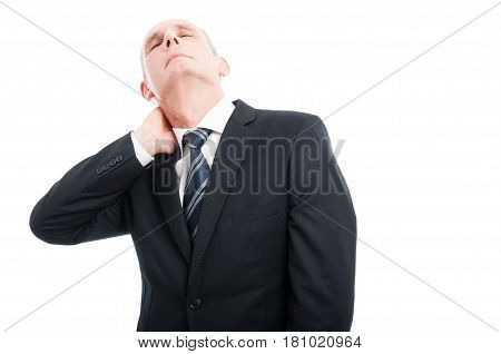 Portrait Of Senior Holding His Neck Like Hurting