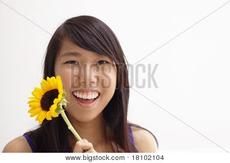 Happy asian lady with yellow flower