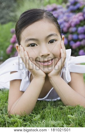 Mixed Race girl laying in grass