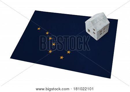 Small House On A Flag - Alaska