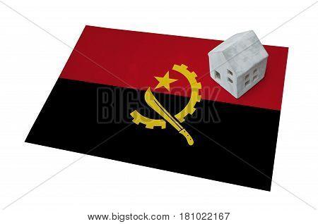 Small House On A Flag - Angola