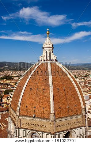 The Duomo, Florence, Italy - July 12, 2012: Top of the Cattedrale di Santa Maria del Fiore is the main church of Florence, Italy.