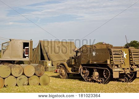 WESTERNHANGER, UK - JULY 21: A US army half track vehicle is parked in a supply dump within the living history section at the War & Peace Revival show on July 21, 2016 in Westernhanger