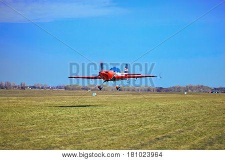 Flight of a sport aircraft against a blue sky.