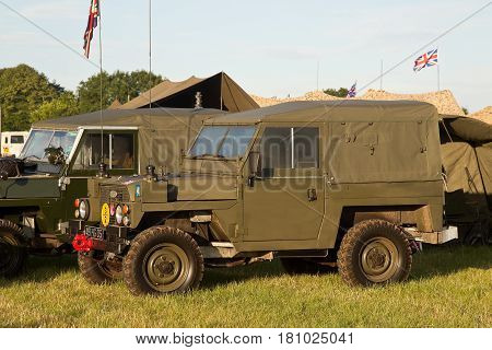 WESTERNHANGER, UK - JULY 21: A modern Land Rover military vehicle is camped in one of the outer fields for the public to view at the War & Peace Revival show on July 21, 2016 in Westernhanger