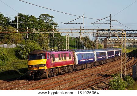 LINSLADE, UK - JUNE 3: The Caledonian sleeper service from Scotland to London heads toward Linslade tunnels on June 3, 2015 in Linslade. The UK only has two sleeper services, the Caledonian being one.