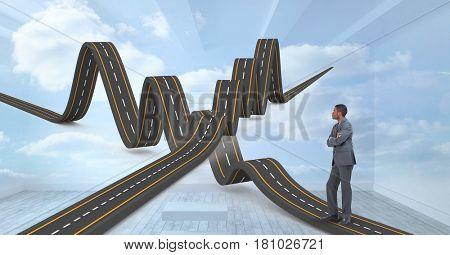 Digital composite of Digital composite image of businessman with wavy roads
