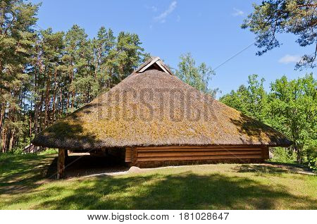 RIGA LATVIA - JUNE 13 2016: Threshing house (erected in 1730s reconstructed in 1994) of Rizgas farmstead of Vidzeme ethnic group. Exhibited in Ethnographic Open-Air Museum of Latvia since 1928