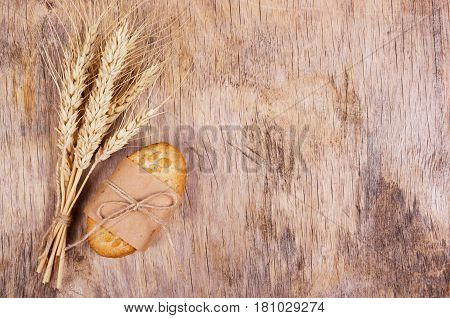 A stack of homemade cookies and spikelets of wheat. Useful organic food. Copy space