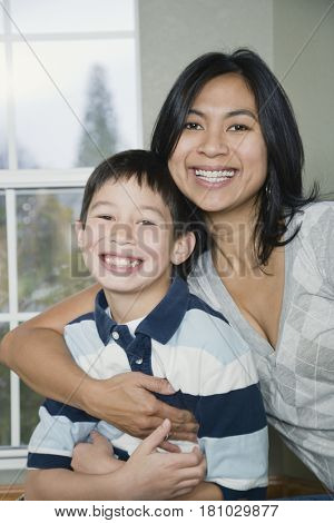 Mixed Race mother and son hugging