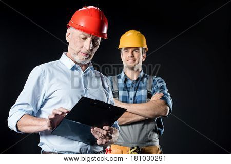 Workman And Architect With Clipboard