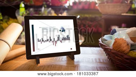 Digital composite of Business graphs on table PC screen