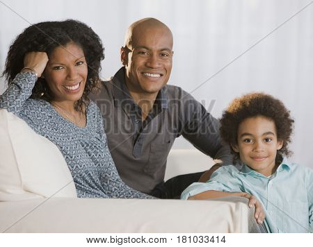 African family sitting on sofa
