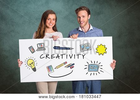 Digital composite of Couple holding bill board with signs and creativity text