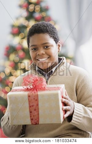 African boy holding gift