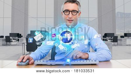 Digital composite of Businessman at futuristic desk