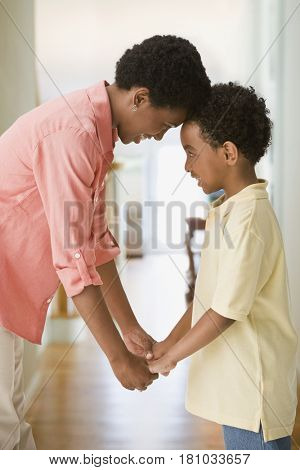 African mother and son holding hands