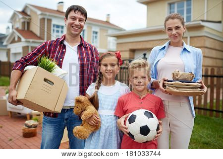 Family with boxes and packed things during relocation