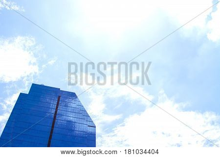 The building reflects with blue sky  for background.