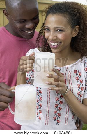 African couple drinking beer