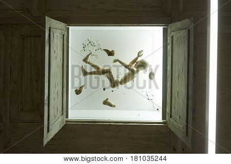 Abstract picture of an drowning wooden dummy in an aquarium. Abstract Ceiling with falling doll.