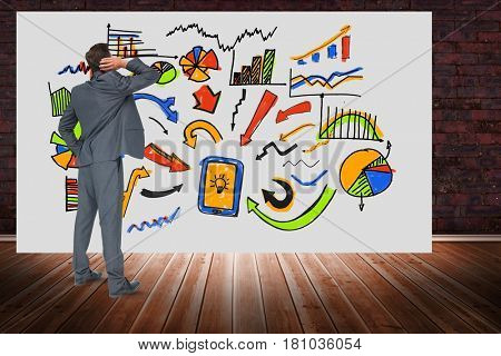 Digital composite of Digitally generated image of businessman looking at various graphs on billboard against brick wall