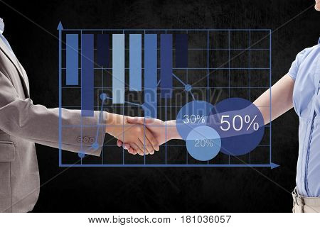 Digital composite of Digital composite image of business partners shaking hands by graph