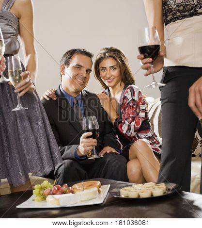 Multi-ethnic couple at party