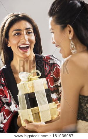 Middle Eastern woman receiving gift