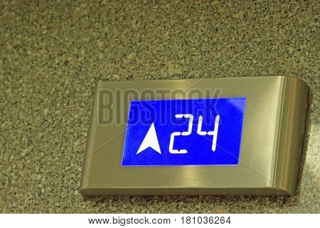The number tells the 24th floor of the elevator in under ligthing.