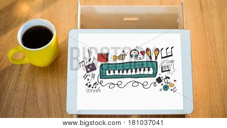 Digital composite of Digital composite image of piano on tablet PC by coffee cup