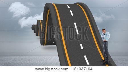 Digital composite of Digital composite image of businessman standing on wavy road