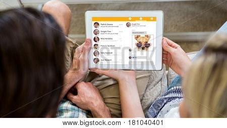 Digital composite of Overhead view of people using digital tablet while sitting at home