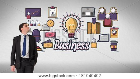 Digital composite of Businessman looking at various icon against gray background