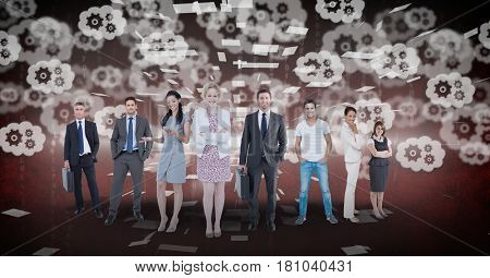 Digital composite of Digitally generated image of business people standing with gears flying in background
