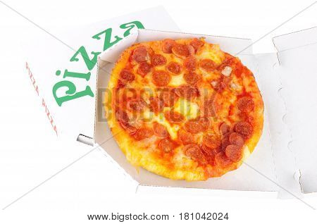 Small pepperoni pizza in a take away box isolated on a white background