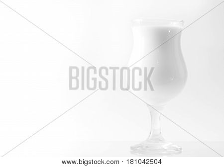 Beautiful glass with milk on a white background