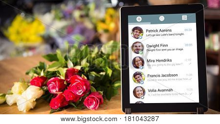 Digital composite of Close-up of chat list on digital tablet by flower at table